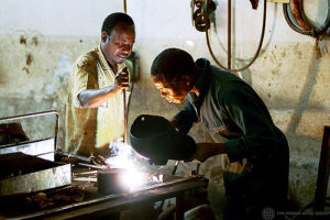 (photo: Workers doing maintenance, by World Bank, (CC BY-NC-ND 2.0)